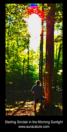 Psychic Sterling Sinclair Oracle Auracature art Standing with Tree in the morning sun Outside